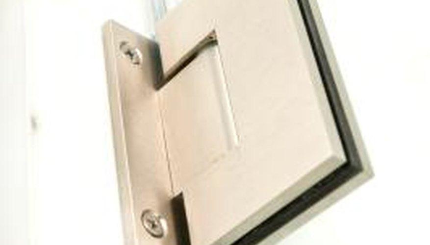 Frameless pivot shower doors have a few different hinge styles.