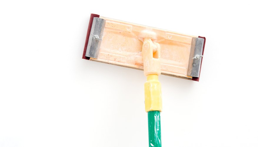 Use a pole sander if you do not have an electric sander.