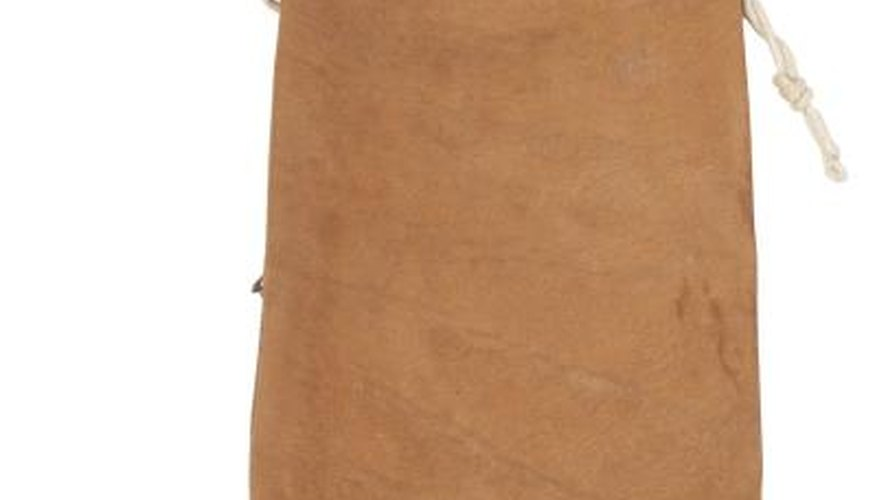 Dye a suede purse to give a new look.