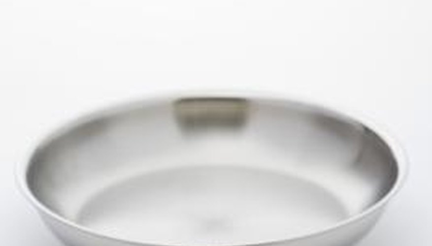 A frying pan can cook food more quickly because it is shallow.