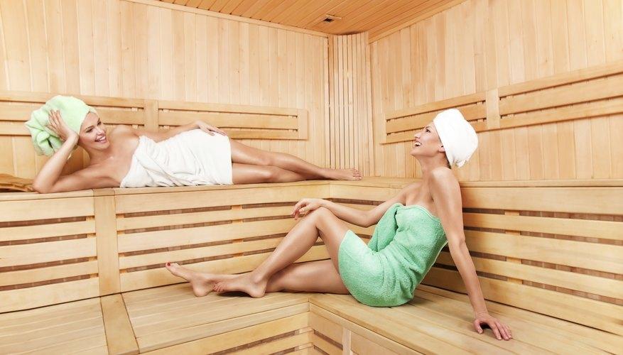 Two women relax inside sauna