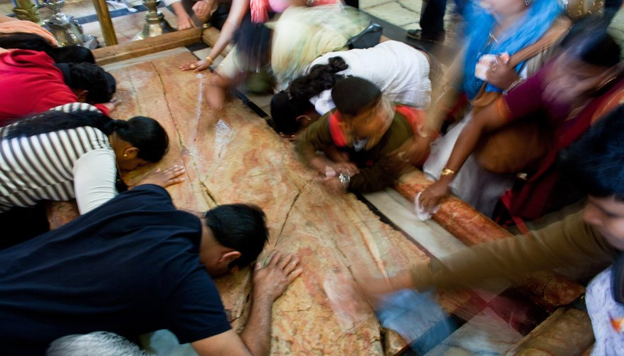 Pilgrims kiss the stone slab where the body of Jesus was anointed before burial at the Church of the Holy Sepulchre in Jersualem.