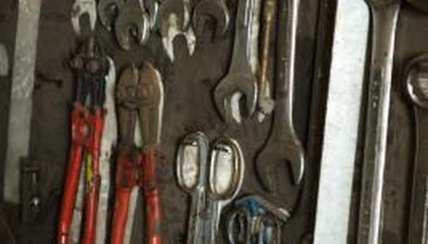 Dip metal such as tools in paint to protect from rust and corrosion.