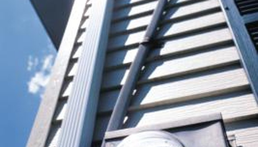 Electricians bend conduit so it can be installed around obstacles.