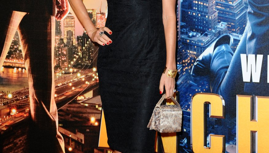 Charlotte Jackson wears brushed gold pumps with a black dress at the UK premiere of