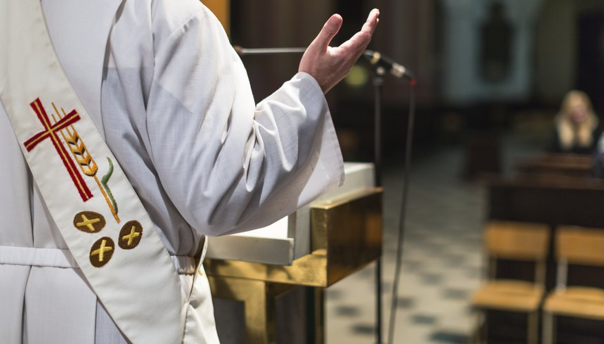 Catholic deacon standing in front of church pews