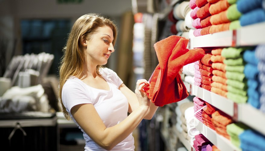 Woman shopping for towels.