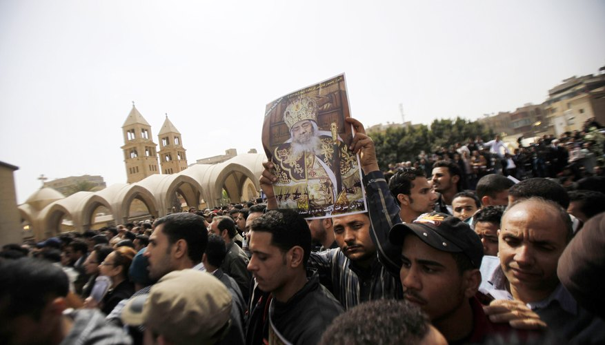 Copts mourn the death of their pope outside a Coptic Cathedral in Cairo, Egypt.