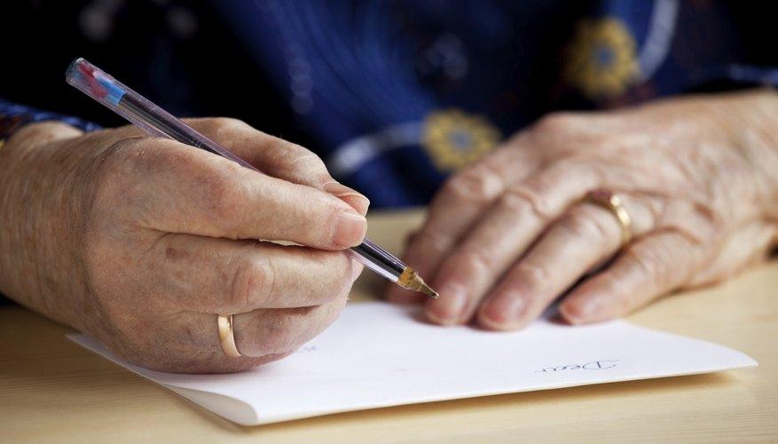Senior woman writing a letter.