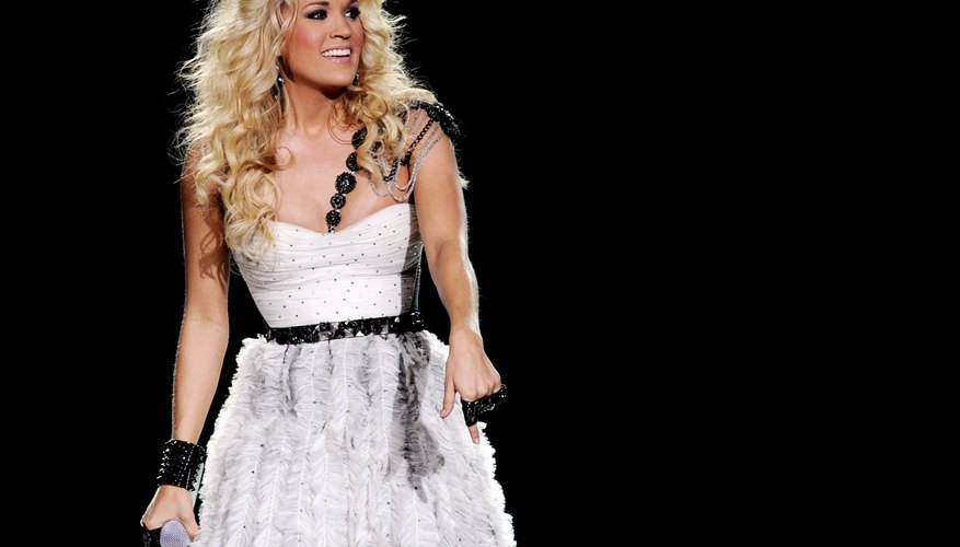 Carrie Underwood has opted for Farrah-inspired volume many times.