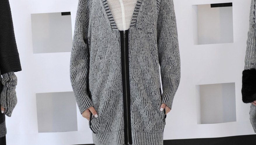 A model wears a long gray cardigan over a thin white tee for a head-to-toe neutral look during Fashion Week in New York in February 2014.
