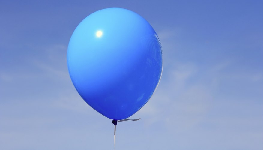 A blue balloon in the sky.