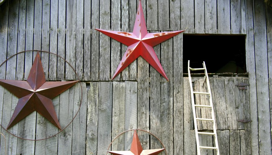 Three large barn stars on a barn near the hay loft.