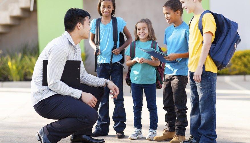 Teacher speaking with elementary school students.