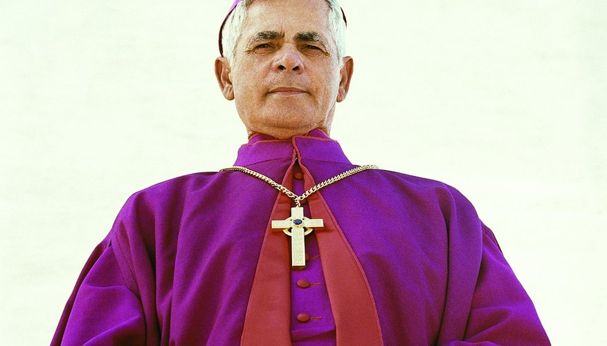 The priest wears a violet stole to administer the Sacrament of Penance.