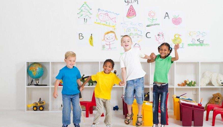 Kindergarteners celebrating in classroom.