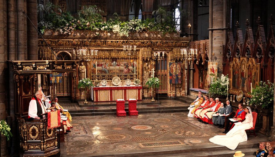 The Lord Bishop of London reading from the pulpit in Westminster Abbey.