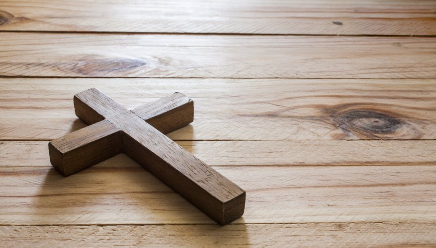 A cross on a wood surface.