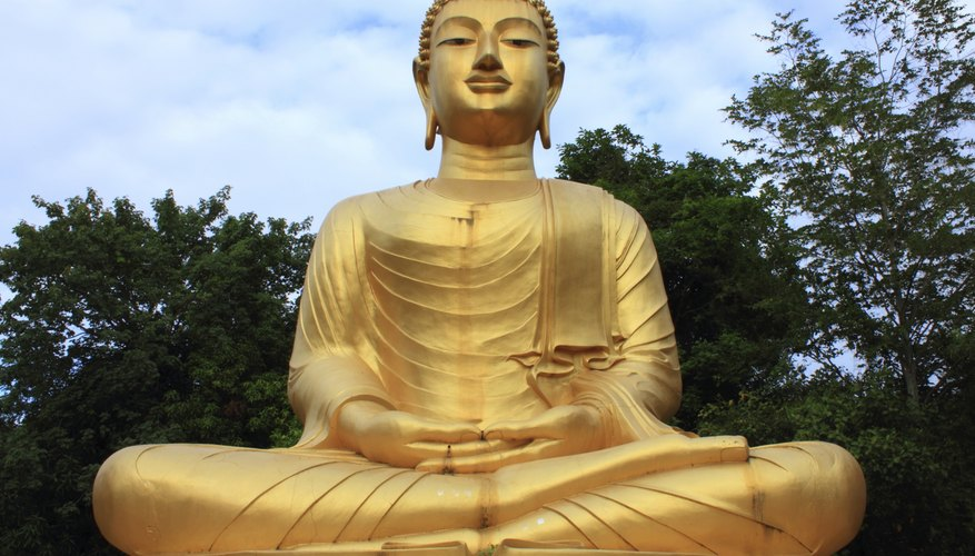 A large gold statue of the Buddha