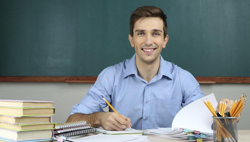 Professor grading papers at desk