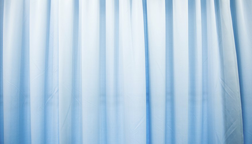 Blue curtains covering a window.