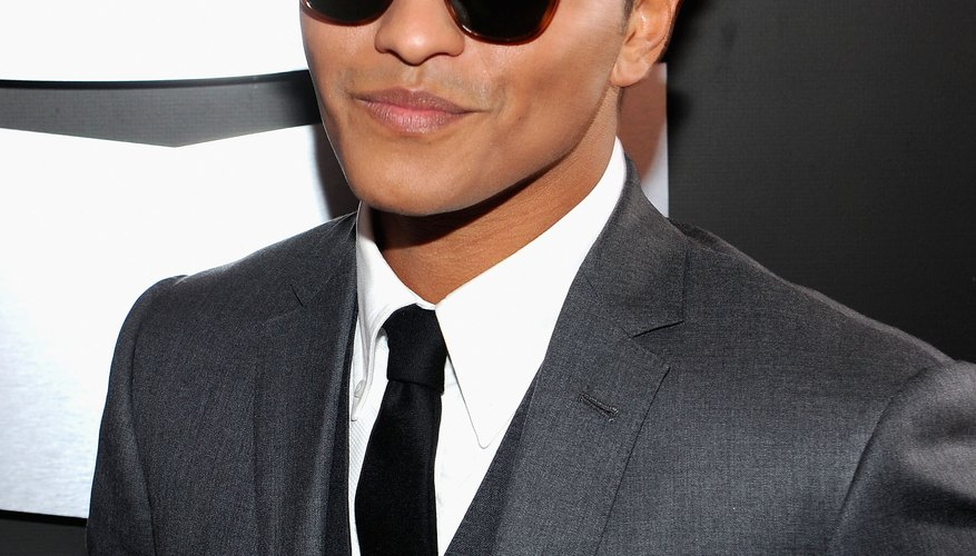 Bruno Mars often balances out a tailored suit with a pompadour.
