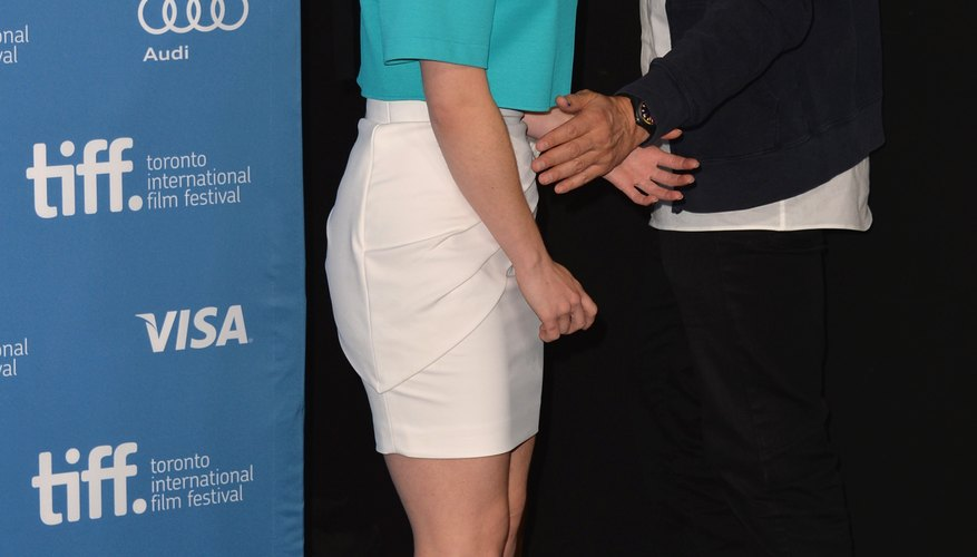 Actress Emilia Clarke pairs a turquoise shirt with a crisp white skirt.