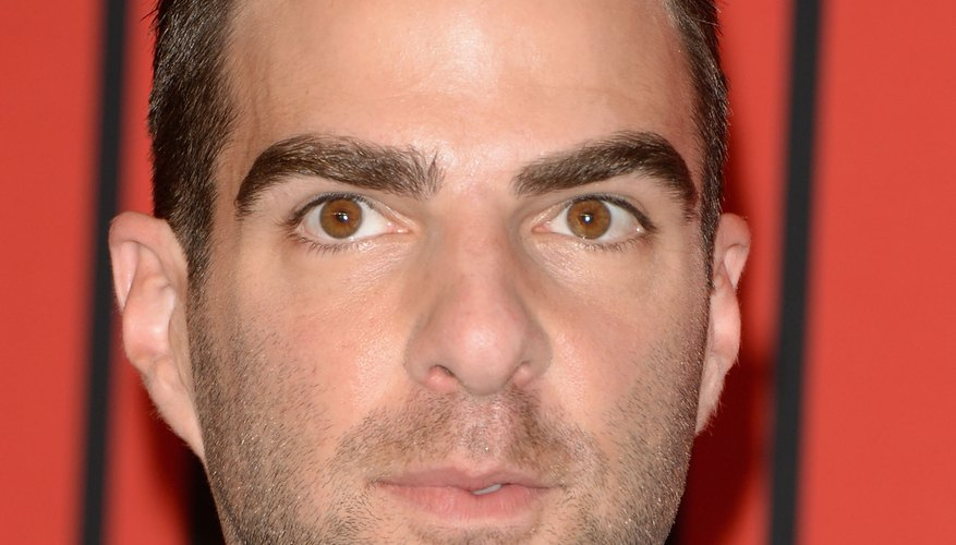 Zachary Quinto sports a straight-back pompadour with a close fade on the sides.
