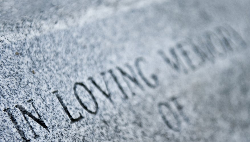 A headstone inscription helps to commemorate a loved one.