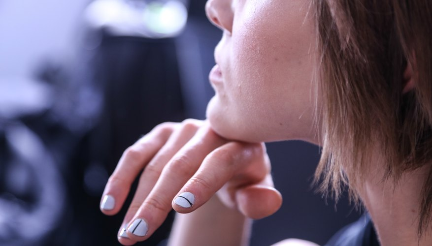 A model shows off her manicure backstage at the JINsoon for Tibi show during New York Fashion Week in September 2013.