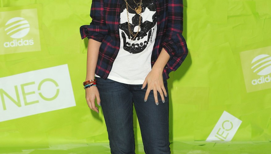 Selena Gomez pairs a flannel shirt with sneakers at an Adidas conference in Los Angeles.