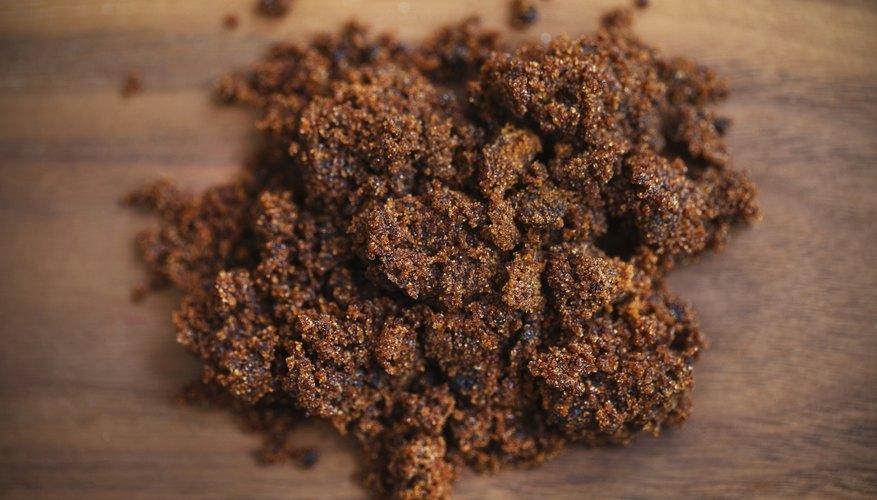 Brown sugar molasses on a wood table.