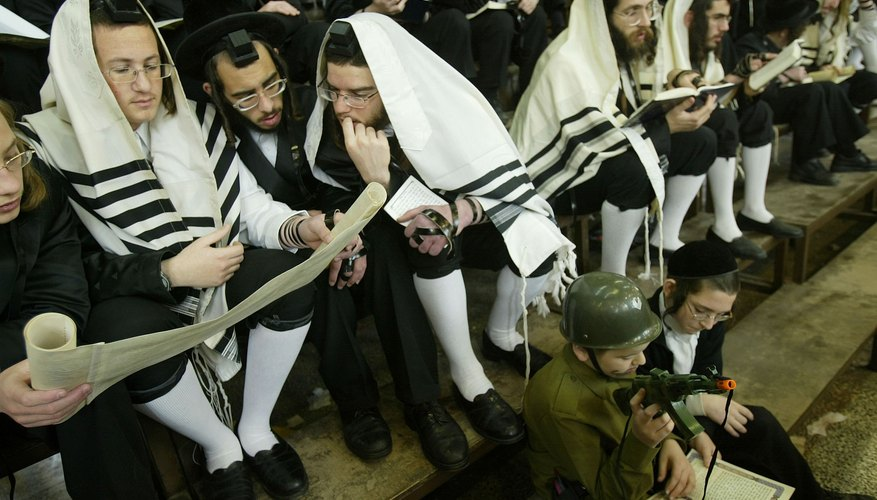 Ultra-Orthodox Jews read from the Book of Esther during Purim in Israel