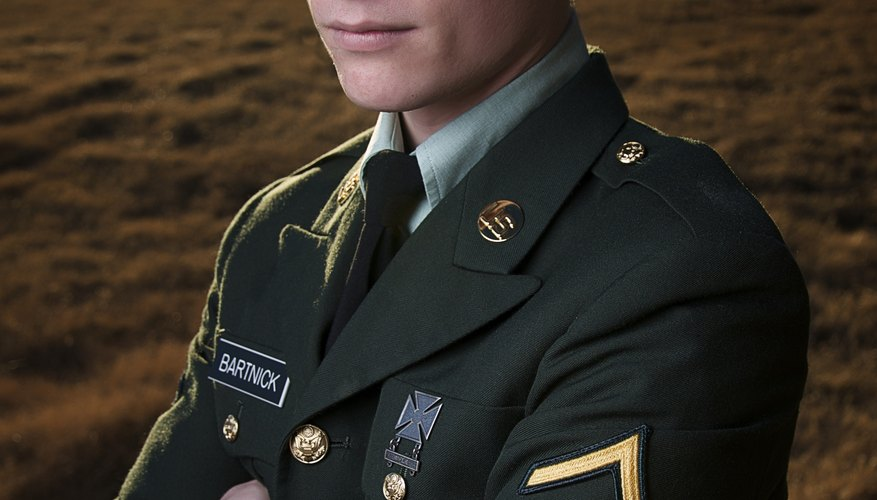An ROTC student in full uniform standing outside