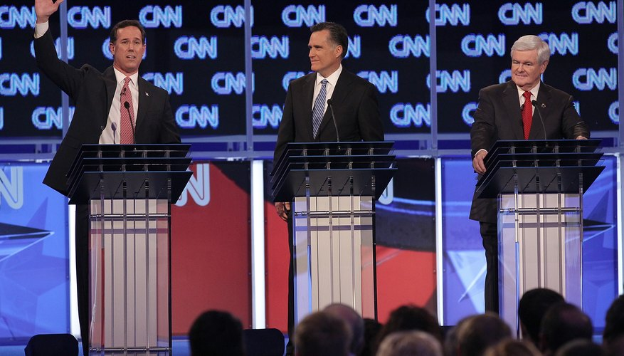 Senator Rick Santorum, Governor Mitt Romney and Former House Speaker Newt Gingrich in a 2012 Republican Primary Debate.