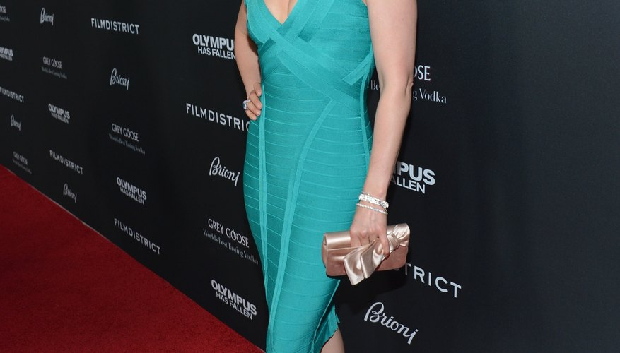 Actress Ashley Judd rocks a teal dress with gold shoes at the Hollywood premiere of