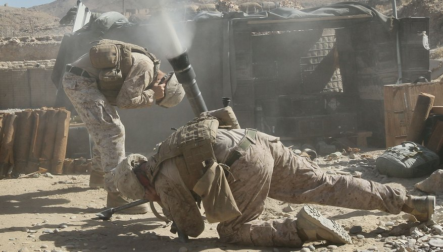 Marines fire mortar rounds to help their fellow Marines in a firefight