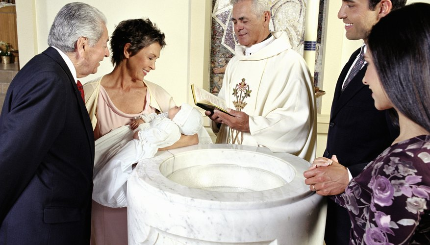 During baptism, water symbolizes new birth into the Holy Spirit.