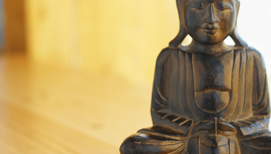 A statue often depicts a  seated Buddha.