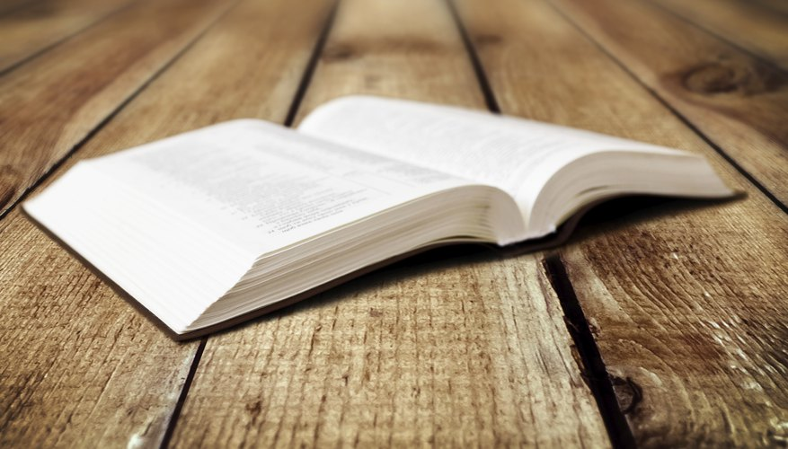 Open bible on wood table.