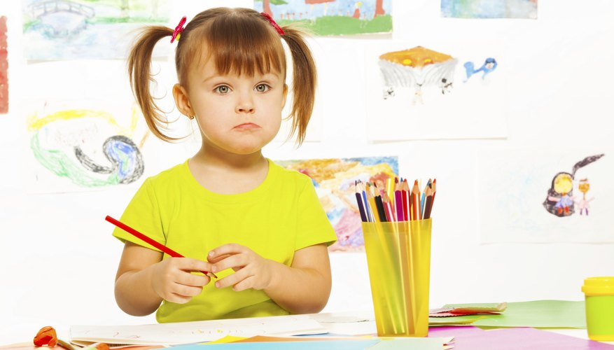 A child drawing a picture at school.
