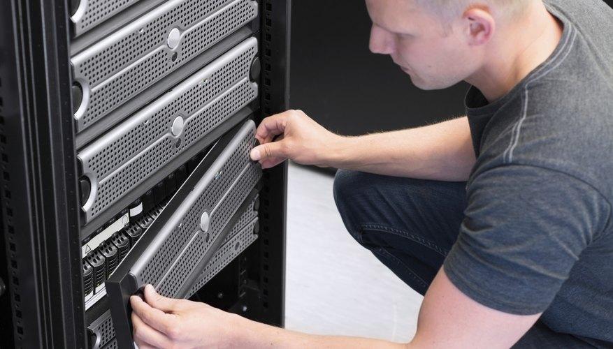 A technician works on a server mainframe.