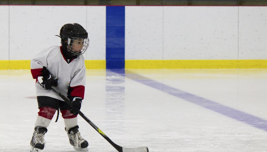 Young child playing hockey.