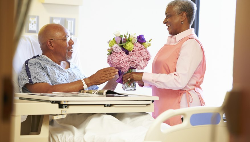 Male patient receiving flowers.