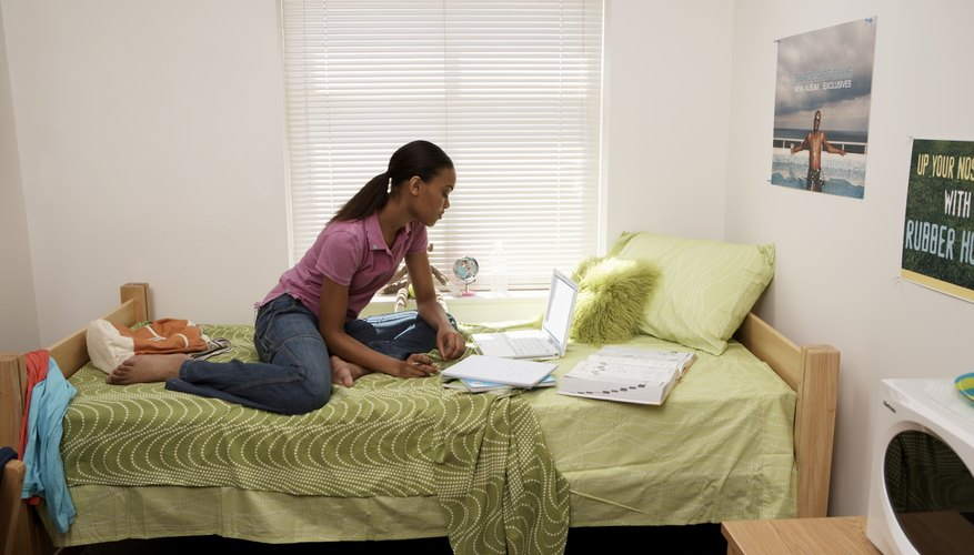 Student studying online in dorm room
