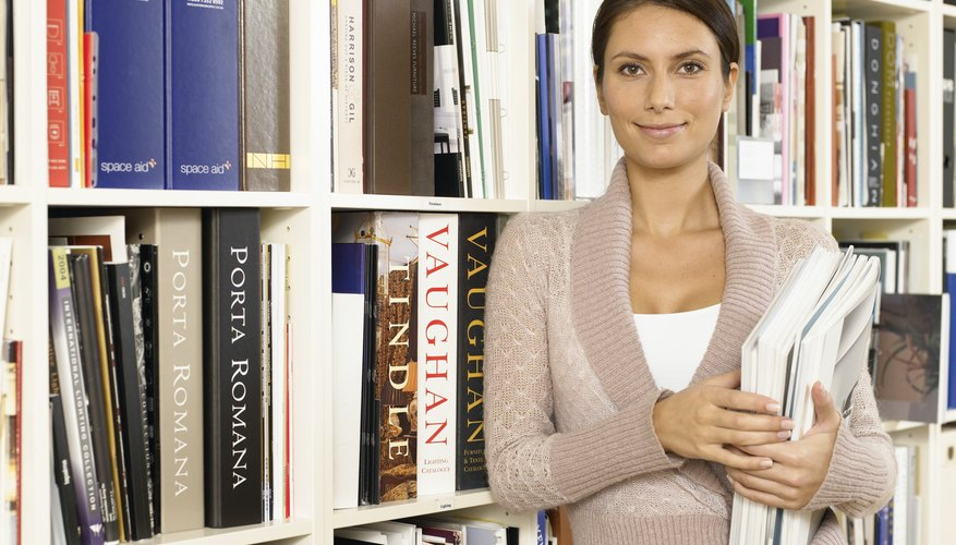Young woman holding books in library