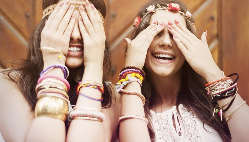 Two hippy girls wearing friendship bracelets.