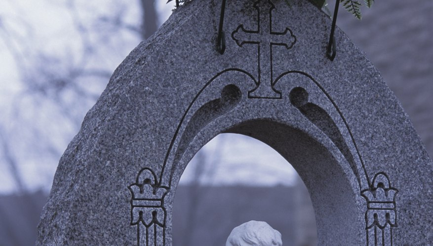 Flowers, either real or silk, can add a touch of color and beauty to headstones and cemetery markers.