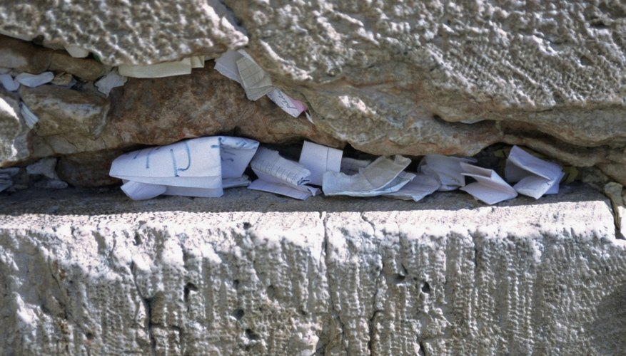 Prayers tucked into a crevice in the Western Wall.