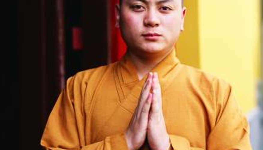 The Wai gesture serves as a simple and respectful greeting with a Buddhist monk.